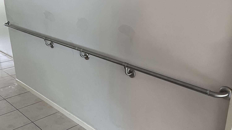 Long custom grab rail in hall